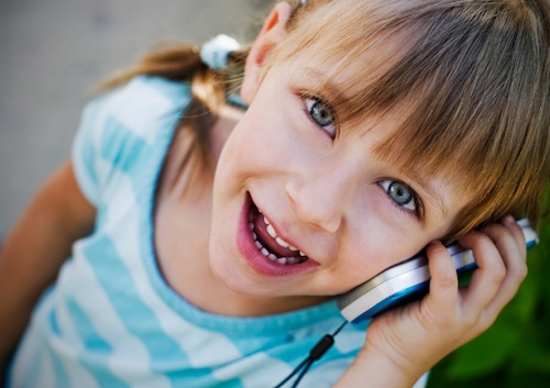 Picture of little girl talking on the mobile phone