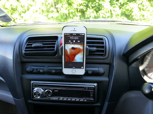 Image of iPhone used in a car for music