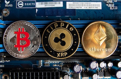 Physical depictions of cryptocurrencies on computer parts, by Marco Vech, modified (CC BY 2.0), https://foto.wuestenigel.com/cryptocurrencies-on-a-computer-parts/