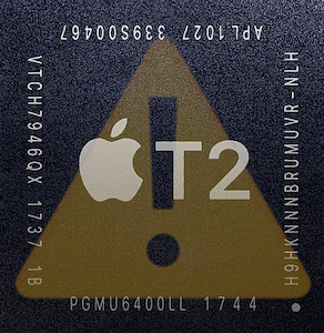 Apple Mac T2 security chip with yellow warning sign exclamation emoji.