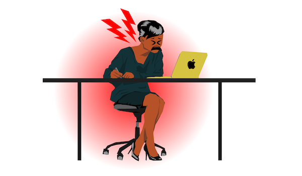 woman sitting at computer with painful bad posture - ergonomics how-to