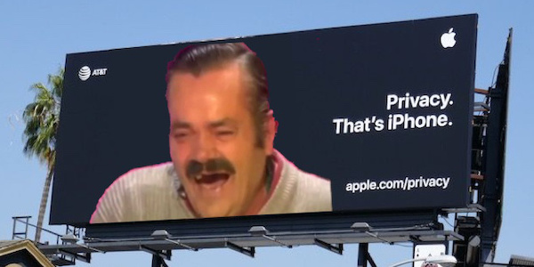 Privacy - That's iPhone billboard with laughing man meme superimposed.
